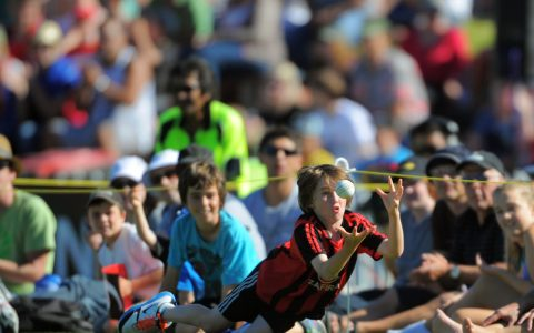 A young fan tries to catch a ball on the boundary. Fill The Basin for Christchurch fundraising cricket match - Canterbury Invitational XI v Wellington Legends XI  at Hawkins Basin Reserve, Wellington, New Zealand on Sunday, 13 March 2011. Photo: Dave Lintott / lintottphoto.co.nz